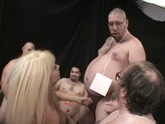 One Horny Blond Slut in the Middle of a Chub Orgy