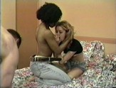 Interracial threesome in hotel room.