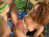 Shaved ebony beauty gets plugged on a park bench