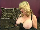 Over the hill dominatrix toys her huge tits and pussy