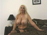 MILF hooker with huge boobs gets bent over in the motel room