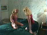 two blonde lesbos share double ended dildo passionately