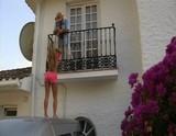 Balcony blowjob