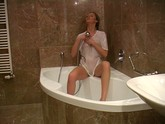Blonde Plays With The Shower Head