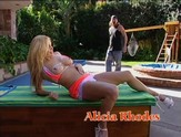 Blonde sucks a huge biker cock by the pool.