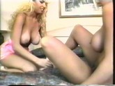 """Two lusty and busty blondes in high heels and pink dresses, get dirty with dildos"""