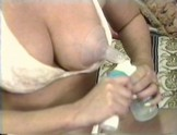 Busty MILF Milks Both Her Tits!