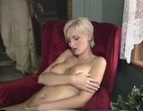 Short haired blonde strips and plays with herself