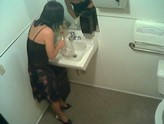 Hidden camera catches woman pissing in coffee pot.