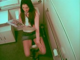 Office babe gets caught on cam reading a sex book and masturbating