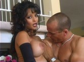 Curly-haired brunette in lingerie sucks then fucks a big dick