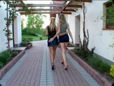 Two hot woman walking and talking