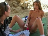 Young brunette outdoors replaces toys with real thing